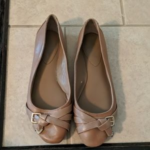 Tan leather flats with gold buckle